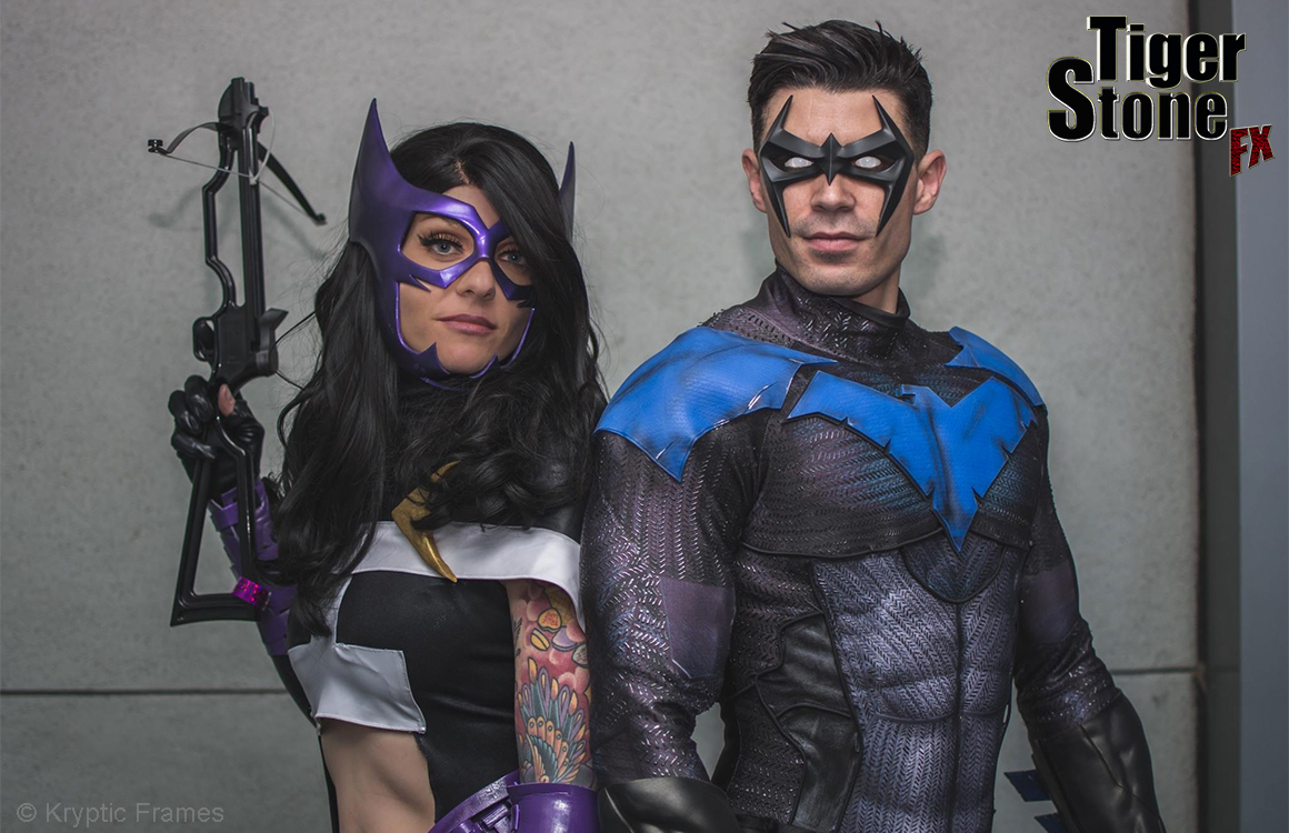 Nightwing and Huntress cosplay by Dynamite Webber and Nerd Alert - Both masks and Nightwing emblems and gauntlets by Tiger Stone FX - Photo by Kryptic Frames